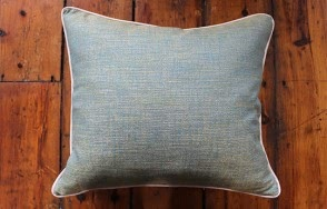 Green cushion with silver trim
