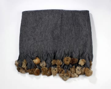 Dark grey pom pom blanket