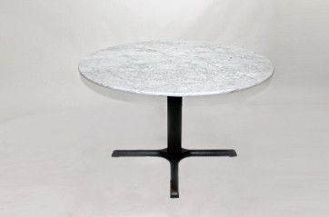 Large black cruciform table with white marble table top