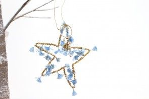Brass beaded star with tassels
