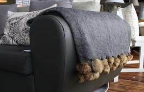 Dark grey pom pom blanket