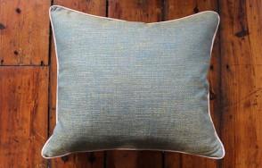 Green cushion with silver trim