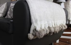 Light grey pom pom blanket
