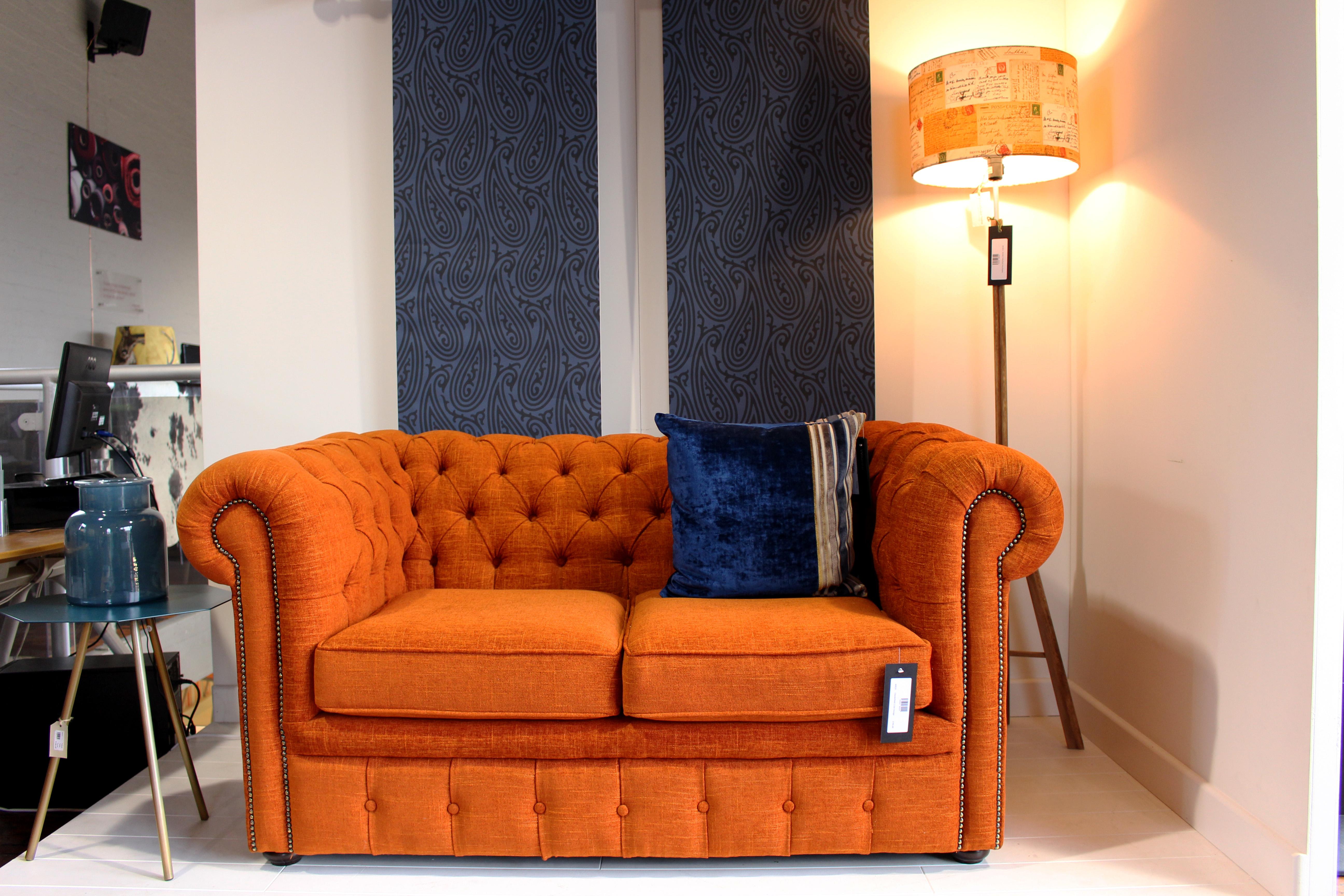 Orange chesterfield sofa